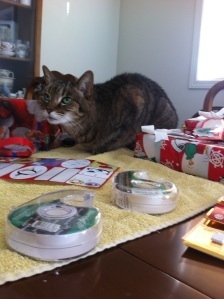 "The little fur person ""helping"" with wrapping presents"